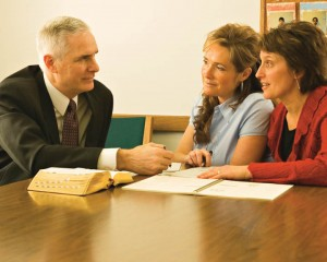 Mormon Leader Helping Members