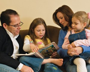 A mormon family enjoys a family night lesson together.