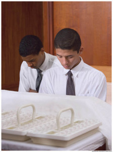 Mormon boys bless the Mormon sacrament (communion).