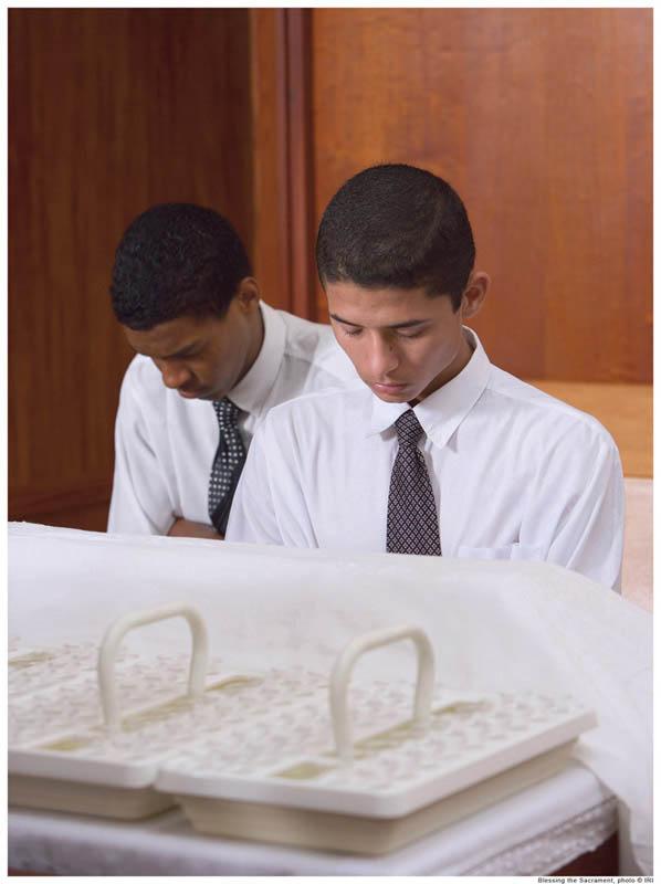 Mormon boys bless the Mormon sacrament (communion).