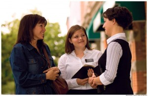 Mormon missions teach leadership skills. Image of female missionaries teaching a woman.