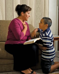 Mormon Mother reading scriptures with on