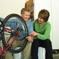 couple repairing bike