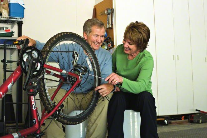 couple repairing bike
