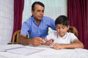 father and son studying at home