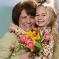 Child giving mother flowers