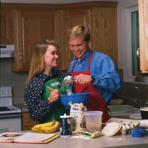 young couple cooking together