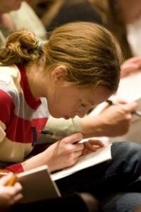 Girl taking notes in school