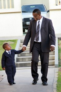 Father and son walking to General Conference