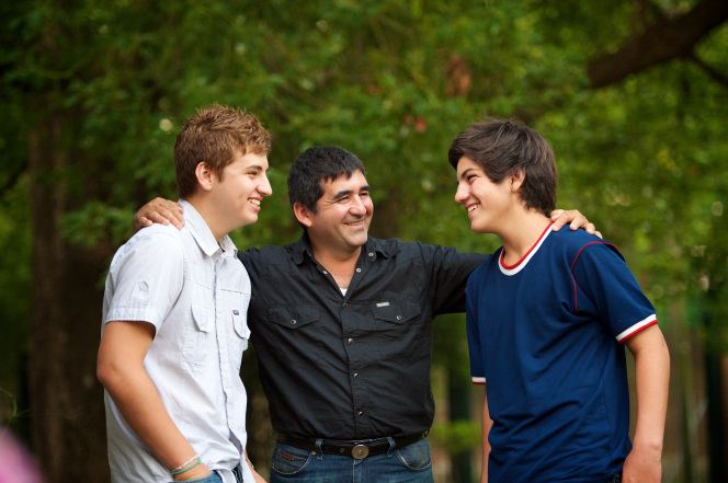 father talking with teen sons