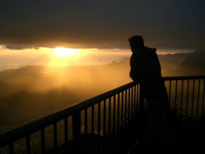 Man watching the sunset from balcony