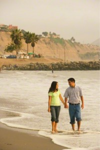 couple walking on beach.
