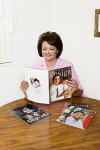 woman reading Mormon magazines