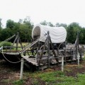 covered wagon sitting on raft at Nauvoo, Illinois