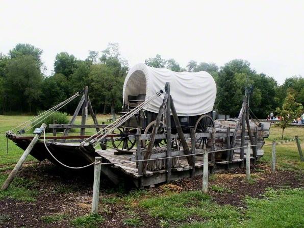 covered wagon sitting on raft at Nauvoo, Illinois