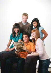 Youth reading LDS magazine