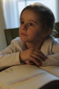 child pondering or listening