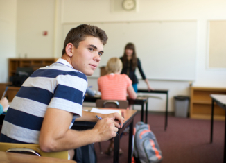 Teen boy in class