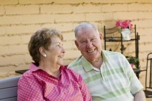 Older couple sitting together outside