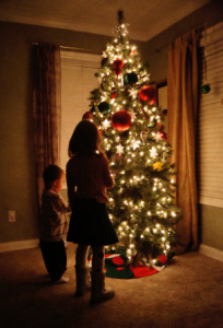 children looking at a Christmas tree