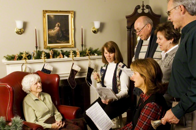 singing Christmas carols to an older woman
