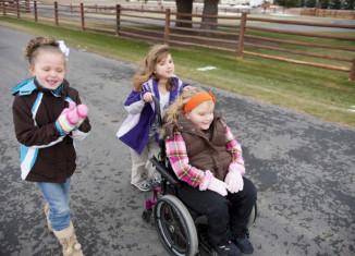 children with one child in a wheelchair