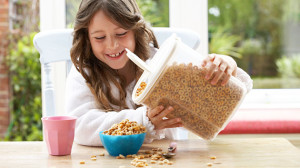 girl pouring cereal
