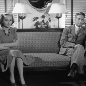 B&W shot of 1940's couple sitting apart