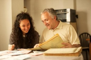 Father and daughter working on genealogy together