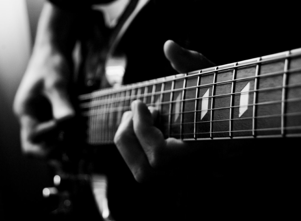 B&W hands on guitar