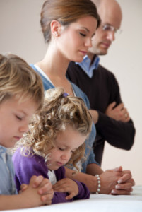 family-kneeling-prayer-889739-gallery