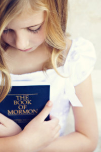girl-holding-book-of-mormon-1062186-gallery
