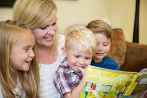 mother-children-reading-friend-1236378-gallery