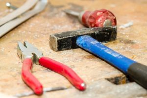 Pliers, Hammer, and tools.