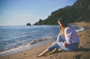 woman beach alone sad
