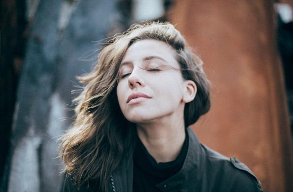 content woman breeze wind